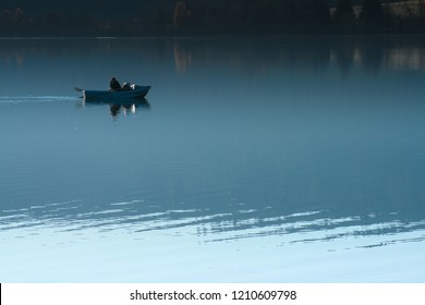 Angler on Schluchsee, Germany in the evening