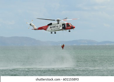 Anglesey Wales UK - August 15 2015: British HM Coastguard helicopter Sikorsky S-92 operated by Bristow Helicopters conducting a rescue exercise off the coast of Moelfre Anglesey North Wales