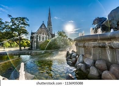 The Anglican (Episcopal) church in Copenhagen, Denmark with the Gefion fountain.