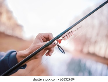 Angling. Close up photo of fisherman hand and fishing lure. Sport, recreation, lifestyle