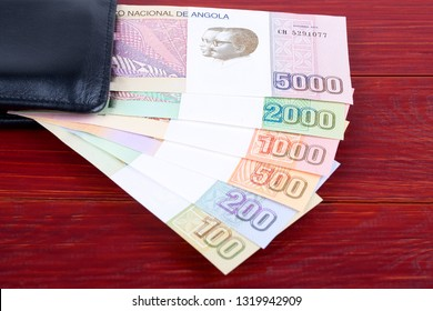 Angolan money in the black wallet