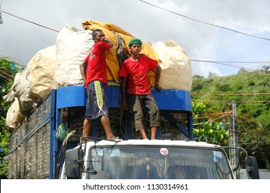 ANGONO, RIZAL, PHILIPPINES - JULY 4 2018: Worker of a materials recovery facility deliver a truck load of plastic waste materials for sorting and segregation.