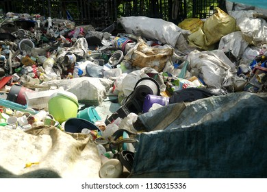 ANGONO, RIZAL, PHILIPPINES - JULY 4 2018: Assorted plastic waste materials at a materials recovery facility ready for sorting and segregation.