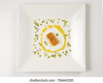 ANGOORI PETHA SERVED IN A WHITE PLATE