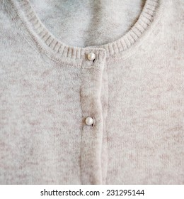 Angora pastel color cardigan with pearl buttons. Close up