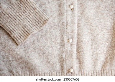Angora wool cardigan with pearl button. Selective focus.