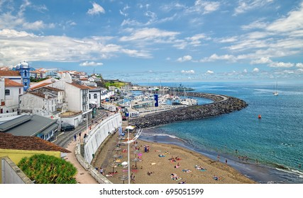 ANGRA DO HEROISMO, AZORES, PORTUGAL - JUNE 24, 2017: Beach and marina in Angra do Heroismo city, located of Azorean island of Terceira, Portugal.