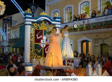 ANGRA DO HEROISMO, AZORES, PORTUGAL - JUNE 23, 2017: Traditional evening parade of Sanjoaninas (St. John) festivities on main street of Angra do Heroismo city on Azorean island of Terceira, Portugal.