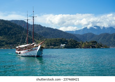 Angra Dos Reis, Brazil - September 2013: Sailing boat with tourists anchored in the Lagoa Azul area