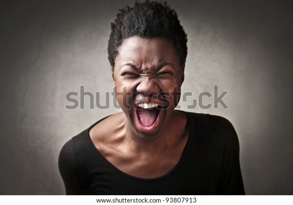 Angry african woman shouting
