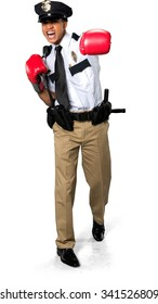 Angry African young man with short black hair in uniform using boxing gloves - Isolated