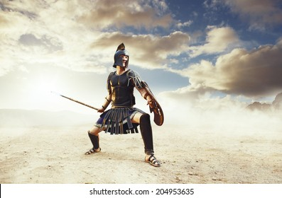 Angry ancient Greek warrior fighting in the combat
