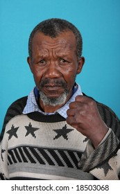Angry and annoyed African man against blue background