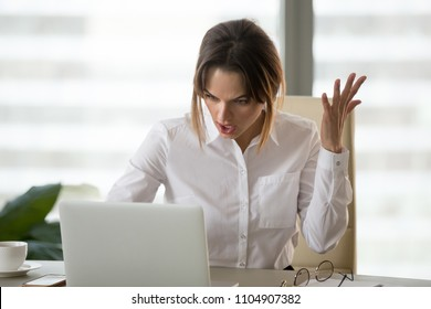 Angry annoyed businesswoman hates not working stuck laptop, furious office employee feels mad frustrated about bad email, online news, pc error, data loss, stressed woman outraged by computer crash