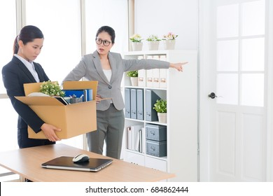 angry annoyed company manager woman fired young beautiful office worker employee girl.