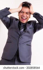 Angry Asain businessman pulling his hair