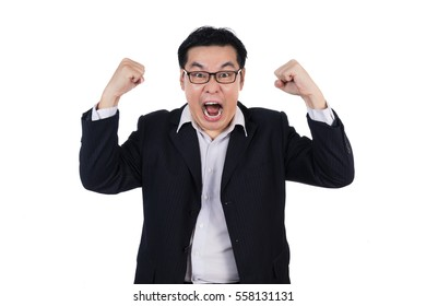 Angry Asian Chinese man wearing suit and holding both fist in isolated white background.
