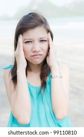 Angry Asian woman on the beach
