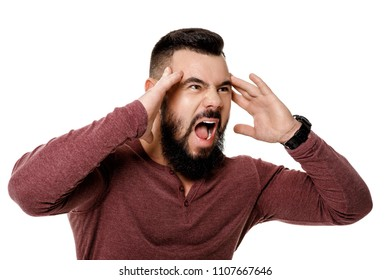 angry bearded man screaming on white background.