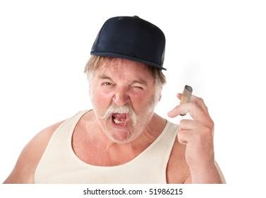 Angry big man in tee shirt with cigar and baseball cap