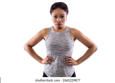 Angry black female wearing athletic outfit on a white background as a fitness trainer