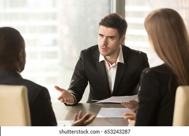 Angry boss dissatisfied with bad work result, displeased businessman holding contract arguing with contractor, demanding termination, loss compensation, defrauded cheated investor protecting rights