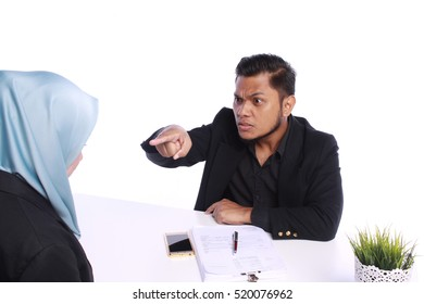 Angry boss firing female colleague by showing  his forefinger