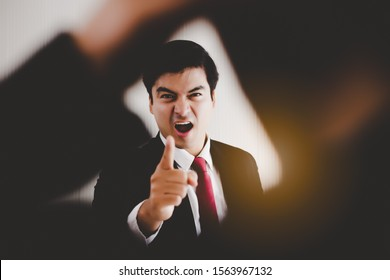 Angry Boss get frustrated, yelling, reprimanding to employee, worker that worker mistake important deadline or work, bossy boss pointing finger to employee. Working person get fired. Irritated manager