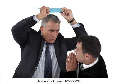 Angry boss hitting employee