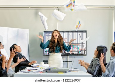 angry boss shout and throw report papers to air with anger due to project off schedule problem and employees in meeting room show frightening manner, selective focus with motion blur