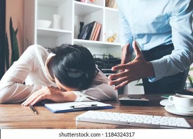 Angry  boss  shouting at his secretary