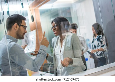 Angry boss with upset face pointing his finger up to female employee making a mistake in business project. Angry boss, frustrated, upset, mistake, fired job concept.