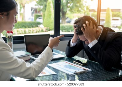 Angry boss,frustrated, upset,mistake,fired job concept.Young businessman(employee) fired on job,stressed bad work.Angry female boss,frustrated,upset face interview and pointing at mad staff.