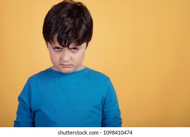 angry boy on yellow background