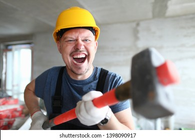 Angry builder holding sledgehammer and shouting at customer on floor apartment under repair. Quick dismantle concept noise walls.