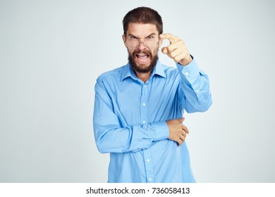 angry business man on a light background studio