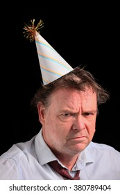 Angry Business Man in a Party Hat