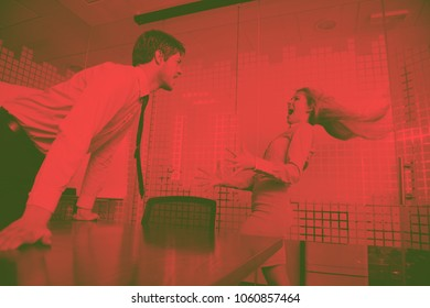 Angry business man screaming at employee in the officeduo tone