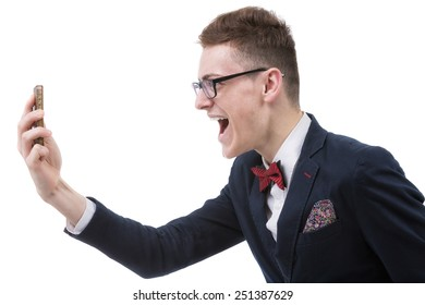 Angry business man screaming on cell mobile phone, portrait of young handsome businessman isolated over white background