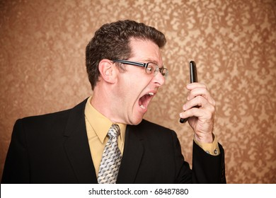 Angry Business Man Shouting at His Phone