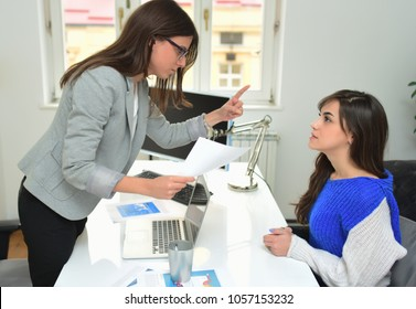 Angry business woman screaming at employee in the office. Mobbing concept
