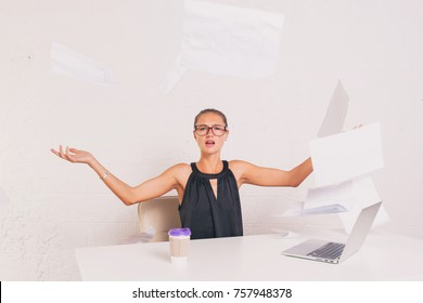 Angry business woman throwing paper in white office