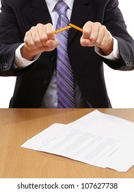 Angry businessman breaking pencil isolated