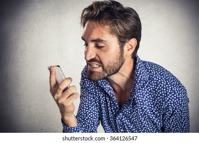 Angry businessman at the cell phone