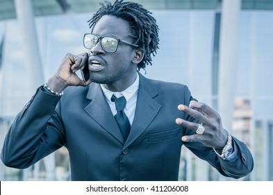 Angry businessman during a call on the phone - black people - concept about people, lifestyle, business and technology