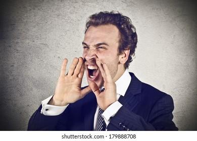 Angry businessman scream