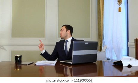Angry businessman screaming to someone