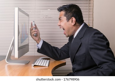 Angry businessman shouting at the phone