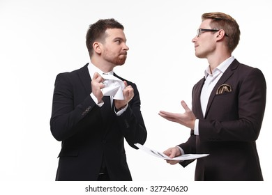 Angry businessman tearing document at the meeting