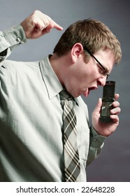 Angry businessman yelling on a phone conversation